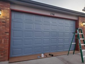 painted garage door, garage door installation in Aurora, Aurora garage door installation, garage door, blue garage door, short panel garage door,
